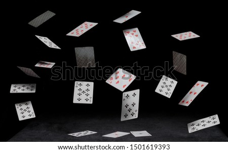 playing cards fall on a black table #1501619393