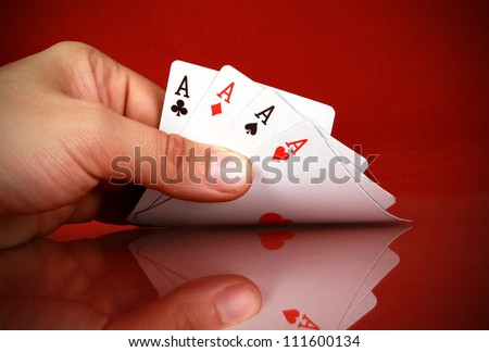 playing cards (four of a kind) in the hand