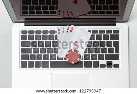 Playing cards on computer keyboard - online poker concept