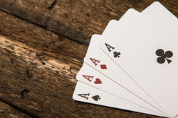 Playing cards on wooden surface