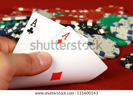 playing cards (pair of aces) in the hand