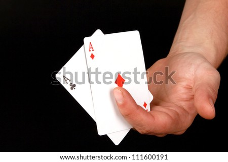 playing cards (pair of aces) in the hand - stock photo