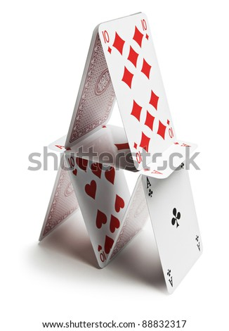 Playing cards pyramid isolated on white close up