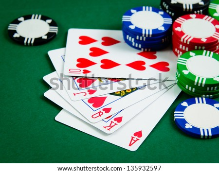 Playing cards show royal flush in poker game