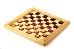 Playing checkers with wooden black and white pawns
