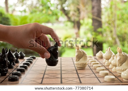 Playing chess game. defeating the opposite team.