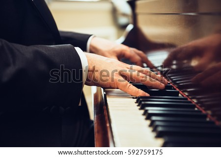 Playing classic piano. Professional musician pianist hands on piano keys.