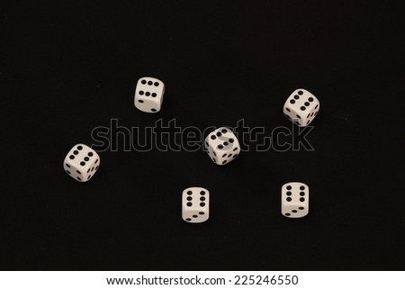 Playing cubes, white dices on black background, Good Luck / good luck in new year  concept