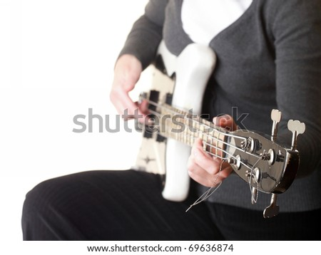 playing electrical bass guitar isolated on white