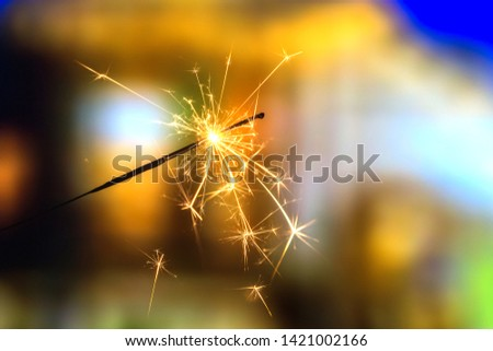 Playing firecrackers sparklers for celebration Christmas, Diwali, Eid Mubarak and all world festival party with blurry background. #1421002166