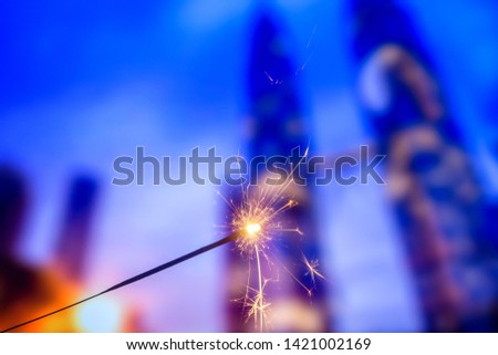 Playing firecrackers sparklers for celebration Christmas, Diwali, Eid Mubarak and all world festival party with blurry background. #1421002169