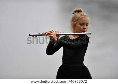 Playing flute #740938072