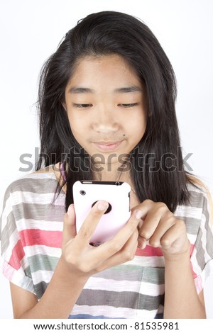 stock photo : playing games, Asian teen girl playing game on smart phone.