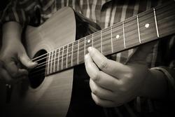 Playing guitar, Close-up shot. sepia tone
