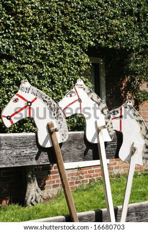 Playing horses made of wood