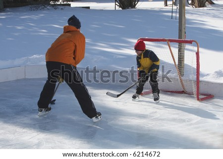 Playing ice hockey on an outdoor ice rink