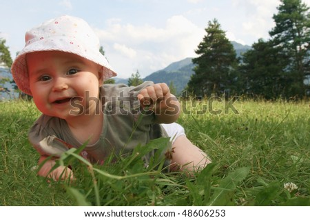 Playing in the nature. Baby in switzerland