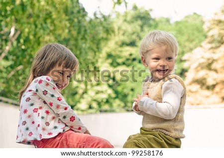 playing little girl and boy in the park