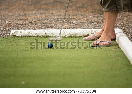 Playing mini golf in the open - stock photo