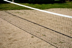 playing net on the sandy football field, badminton, tennis court, in the countryside at the cottage in the school in the yard, forest nursery for children, summer camp in the mountains
