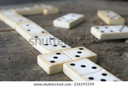 Playing old domino game on wood background