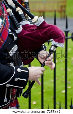 Playing on a bagpipes