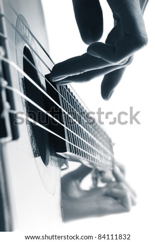 Playing on a guitar on a white.