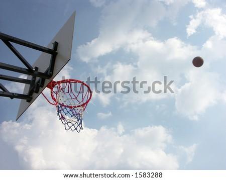 Playing outdoor basketball