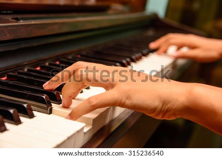 Playing piano #315236540