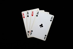 Playing poker cards on dark background