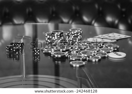 Playing poker chips on a glass table. Playing cards on a gambling table. Gambling, dice, poker.