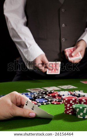 Playing poker in the casino with winning hand