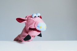 playing puppet on the white background. Pig. reaction. Emotional.