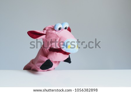 playing puppet on the white background. Pig. reaction. Emotional. #1056382898