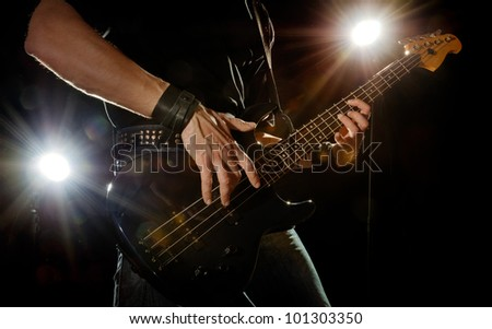 playing rock guitarist surrounded with lights
