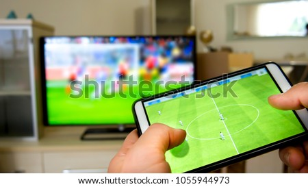 Playing soccer on a TV with a smartphone