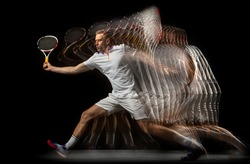 Playing tennis. Young man, male badminton player in motion and action isolated on dark background. Stroboscope effect. Concept of healthy lifestyle, professional sport, action, motion, hobby, team.