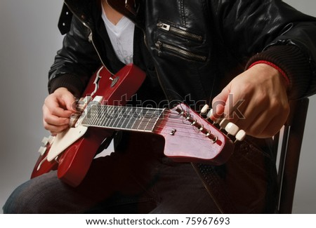 Playing the guitar