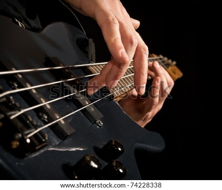 playing the guitar: closeup of hands and strings