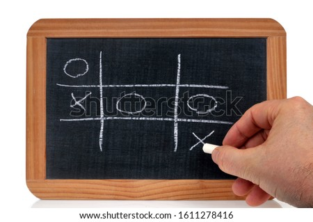 Playing tictac-toe on a school slate with chalk Foto stock ©