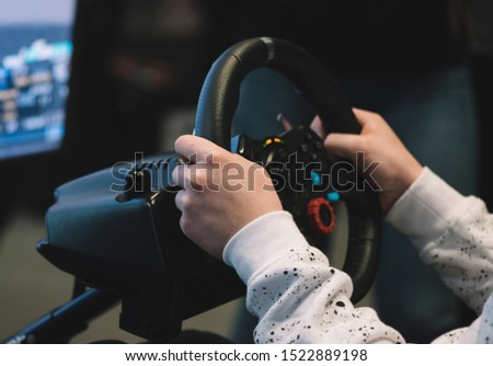 Playing with car simulator at an exhibition