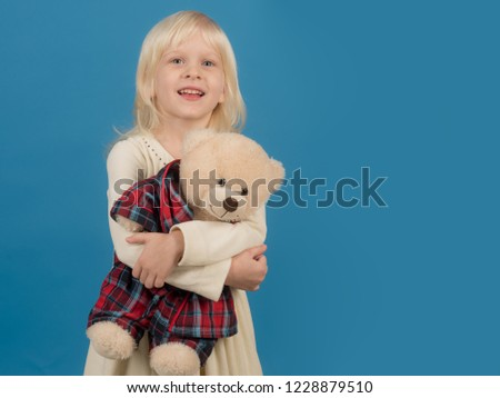 Playing with her toy friend. Small kid happy smiling. Little girl with teddy bear. Small girl hold toy bear. Little child with soft toy. Happy childhood. My favorite childhood toy, copy space.