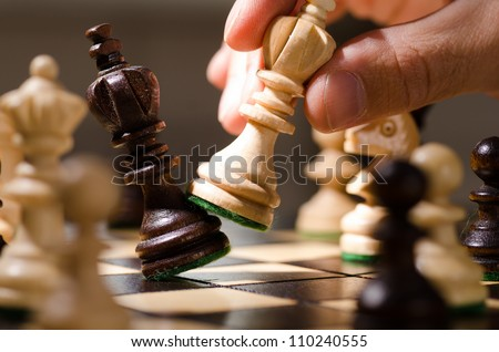 Photo of  playing wooden chess pieces