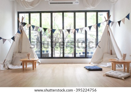 Playroom for kids with Teepee and small drawing tables