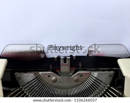 Playwright, occupation title typed on white paper on vintage manual typewriter machine #1106266037