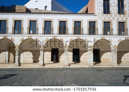 Plaza alta beautiful arabic white and yellow buildings in Badajoz, Spain