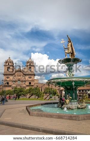 Plaza de Armas with Inca Fountain and Compania de Jesus Church - Cusco, Peru