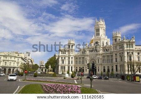 Plaza de Cibeles in Madrid, Spain. With Cibeles Fountain and the Royal Mail office in the background (Palacio de Comunicaciones or Correos)