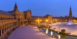 Plaza de España - A panoramic dusk view of Plaza de España on a quiet Autumn evening. Seville, Andalusia, Spain.