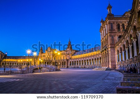 Plaza de Espana in Sevilla at dusk, Spain. panoramic. Built in 1928 for the Ibero-American Exposition of 1929.